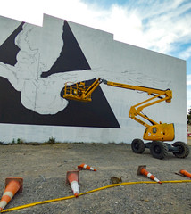 Rabbits and Plastic (Steve Taylor (Photography)) Tags: art graffiti mural streetart crane wall black white yellow orange blue plastic rubble newzealand nz southisland canterbury christchurch cbd city rabbit animal triangle cloud sky road traffic cone tape hazard please keepout restrictedarea