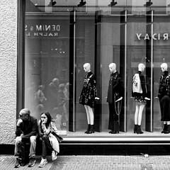 So tired! (Johan Konz) Tags: street man woman couple shopping window shopwindow fashion people reflections amsterdam netherlands outdoor nikon d90 blackandwhite monochrome