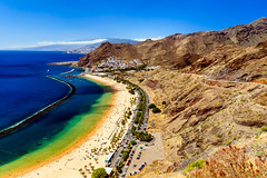 Playa de las Teresitas (DaLiu_) Tags: place beach aerial spain playa lagoon san tree shore travel view touristic volcanic village wave tourist bay sea exotic vacation teresitas canary ocean island coast town tropical cloud sand holiday summer andres anaga shoreline famous taganana high spanish blue mountain sky desert cliff beautiful water sandy nature coastline tenerife palm islas
