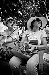 Still Best Friends (stimpsonjake) Tags: nikoncoolpixa 185mm streetphotography bucharest romania city candid blackandwhite bw monochrome oldwomen friends hat sunglasses