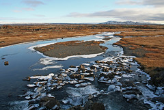 Icelandic Landscape (April.Moulton) Tags: travel sky mountain snow ice nature water field grass clouds canon river landscape iceland nationalpark stream europe canon350d nationalgeographic travelphotography canonphotography ingvellirnationalpark