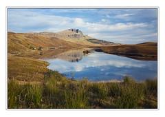 Old Man of Storr - Loch Fada by 3,6,9 Seconds of Light (3,6,9 Seconds of light) Tags: old blue sky man reflection skye water clouds island scotland scenery scottish peaceful loch isle tranquil oldmanofstorr storr