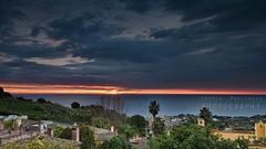L'ultima alba... (Andrea Rapisarda) Tags: red seascape clouds sunrise landscape dawn nikon italia nuvole mare alba sicily catania sicilia d800 endoftheworld mattino acicastello allrightsreserved 211212 andrearapisarda filterhitech100reversegrad09nd