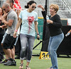 Guadalupe Rodriguez (right), Jennifer Lopez's mother, dances on the football pitch at the Pre