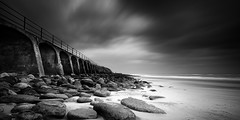folkestone (richard carter...) Tags: sea blackandwhite beach monochrome canon evening kent rocks widescreen arches crop 169 eos5dmk2