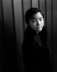 subway school girl by TKBMEDIA - Location: Tokyo, Japan  Camera: Yashica T3  Lens: 35mm  Film: Tmax 400 35mm  Development: Tmax developer 20 degrees 400@200   Paper: Ilford FB glossy 23 degrees