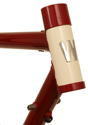 <p>Head tube from a Waterford 22-Series Artisan randonneuring frame with 20mm head tube extension and brazed-on polished block-style headbadge.  Stylied in Garnet Metallic with Vanilla Shake painted head tube.  63115</p>