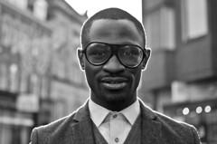 Del (77/100) Explored (drmaccon) Tags: portrait blackandwhite bw man shirt 35mm prime glasses nikon leicester stranger sharp f18 backlighting d5100