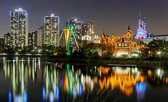Colorful Seoul - Fantasy (Charn High ISO Low IQ) Tags: longexposure nightphotography lake castle canon eos colorful cityscape fantasy seoul amusementpark southkorea hdr waterreflection lotteworld jamsil nightimage 600d jamsilpark
