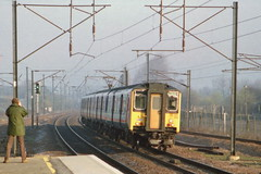 19910330 003 Potters Bar. NSE Liveried Class 317, 317301 Approaches With A Kings Cross Train (15038) Tags: electric br trains emu railways britishrail pottersbar class317 317301