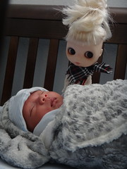 Spock looks over the baby