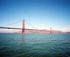 San Francisco (Peter Gutierrez) Tags: california ca bridge blue sky usa sun mamiya film water up america port golden bay harbor us photo gate san francisco looking harbour united under sunny peter american gutierrez americana medium format states 6x7 underneath 67 californian franciscan mamiya7 petergutierrez