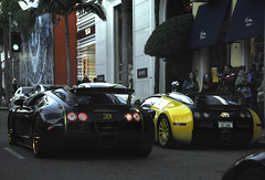 Money...these guys have it (Ian Jones Photography) Tags: black yellow gold drive wheels fast hills exotic rodeo beverly carbon fiber expensive bugatti exclusive supercar linea doro veyron bijan mansory vincero