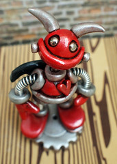 Robot Baby Devil Bert (HerArtSheLoves) Tags: red sculpture baby black smiling silver robot mixed wings media shiny paint heart skin handmade ooak tail gothic rustic gear mini valentine clay springs devil accents coils grungy polymer silvereyes herartsheloves