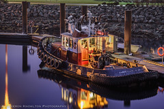 The Little Tug That Could (Cameron Knowlton) Tags: ocean longexposure blue light canada color colour reflection water colors night reflections boats lights boat nikon long exposure glow break colours bc dusk victoria potd tugboat tug tugs tugboats breakwater d600