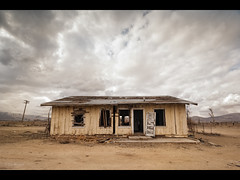 Casa Amarilla (Muzzlehatch) Tags: california portrait storm abandoned home desert failure stormy mojave homestead leftalone