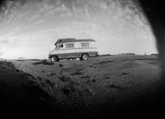 Pinhole Car (AlmaPerdida) Tags: auto white black blanco beach argentina car buenosaires pin hole negro playa pinhole papel estenopeica kentemere