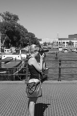 Shooting Blonde (Wookiee!) Tags: girl girls woman women camera shooting photography candid 35mm canon d550 bw monochrome street city blonde urban life venus feminine pretty beauty knot sunglasses summer warm hot straatfotografie streetphotography sunny strangers unpolished unposed blackandwhite blackwhite nl dutch holland amsterdam xxx 020 noordholland northholland capital centre boats water bridge nice sharp crisp monochromia noir blanc netherlands 17 august 2016 wednesday wwwgevoeligeplatennl