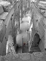 Arles Amphitheatre (AmyEAnderson) Tags: bw blackandwhite color woman person scale limestone architecture collonade tourist angles view arles france bouchesdurhone provence historic stonework unesco