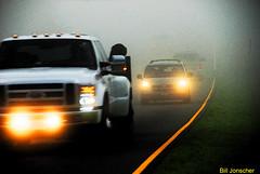 Foggy mountain road (Bill Jonscher) Tags: fog haze mist road traffic lights trucks morning early wet damp cold country rural roadtrip travel