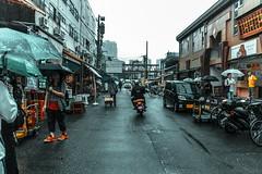 () Tags: tokyo japan chuo tsukiji fish market rain neon umbrellas tokyoto