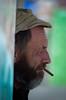 Watching the lobsters (Roel) Tags: france fisherman character smoke watching cigar normandie frankrijk normandy rimpels barfleur karakter