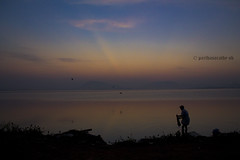 The lonely washer (Parthasarathy.S.K) Tags: morning silhouette canon photography solitude earlymorning chennai silhoutte tamilnadu silhouttes incredibleindia chennaiindia chennaitamilnaduindia chengalpet chennaiweekendclickers canoneos1100d kolavailake sunrisechennai