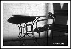 Table And Chair (Light And Shadow) - Commercial Drive JX4851e (Harris Hui (in search of light)) Tags: shadow italy canada vancouver table chair fuji bc richmond fujifilm shadowplay littleitaly commercialdrive lightandshadow thedrive x100 tableandchair digitalrangefinder harrishui vancouverdslrshooter fujix100 retrostylecamera fujixseriescamera cameraforstreetphotographers