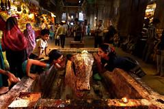 Whisper your wishes (Praveen_Guna) Tags: new india canon temple whisper year prayer wide tokina holy wishes tradition custom hindu 11mm madurai relegion meenakshiammantemple nandhi 2013 incredibleindia praveeng eflensman