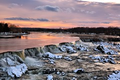 A Happy New Year Sunset (americanadian_8) Tags: city winter sunset sun snow cold river landscape ma massachusetts freezing falls day1 freeze slowshutter merrimack lowell slowshutterspeed pawtucket pawtucketfalls day1365 3652013 01jan13 365the2013edition