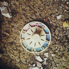 spinner, game of life (Amy Fichter) Tags: life old summer abandoned wheel mobile wisconsin square decay august faded numbers squareformat abandonedhouse spinner 2012 iphone gameoflife iphone4s roadtrip2012 vscocam lyndonstationwisconsin