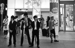 Running Late (Aaron Webb) Tags: bw fashion japan umbrella waiting suits january 大阪 日本 osaka 傘