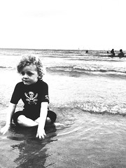 The boy (strictlybearded) Tags: monochrome white black wetsuit canoe waves sea sand summer family son father love holiday sun beach iphone devon dorset