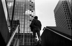 Brisbane - Anzac Sq (alessandro.soro) Tags: brisbane blackandwhite monochrome outdoors skyscrapers cloudy stairway pedestrian ilford hp5 grainy film australia