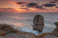 Morning blaze () Tags: sunrise sunray sea seamorning seasunrise blaze morningblaze morning morningcolours colourful rock monument cliff cliffs shore clouds waves bigwaves seawaves bulgaria blacksea tulenovo           black       giant