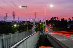 forever circling (pbo31) Tags: california bayarea nikon d810 color august 2016 summer boury pbo31 northerncalifornia fostercity sanmateocounty bridge sunset light pole lightstream traffic skyline urban pink sky motion over view infinity