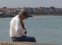 sweet music on the seafront... (maggie224 -) Tags: man musician violin seafront coast margate music sit matchpointwinner mpt507