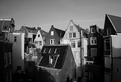 Amsterdam from behind (kismihok) Tags: amsterdam behind behindthescenes city urban blackwhite bw houses downtown jordaan netherlands nex7 1650 sony