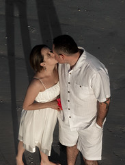 """""""Kiss On The Beach"""" (So Fluid) Tags: kiss wedding white shadow love engagement happy happiness family future unity ecuador southamerica florida fortmyers beach sand canon canonrebel t5i sofluid southflorida south america portrait photography portraitphotography passion sigma 50mm sigmalens"""
