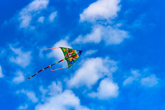 Kite in the sky (drpavloff) Tags: ocean nyc blue sea sky sun kite beach colors clouds wind air wing string