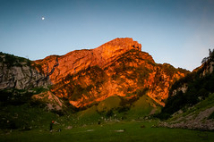 Sunrise over Seealp (medXtreme) Tags: sun moon mountain mountains alps berg sunrise schweiz switzerland mond berge alpen sonne sonnenaufgang gebirge mountainrange massiv meglisalp seealp alpsteinmassiv gebirgszug kantonappenzellinnerrhodenai