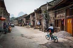Old streets of Xingping (michaeldewitte.nl) Tags: china boy mountains cycling yangshuo limestone karst xingping