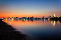 Sunset at Odaiba Beach (chibitomu) Tags: city bridge light sea reflection building beach water japan canon landscape eos tokyo cityscape   odaiba    canonef1740f4lusm 5dmarkii bestevercompetitiongroup besteverdigitalphotography besteverexcellencegallery chibitomu