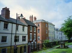 Nottingham. (Esmik D'Aguiar) Tags: film photography fujifilm ga645zi velvia nottingham yellow green railing red brick lamp standard