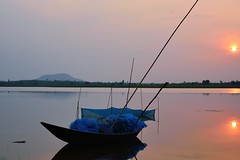 Double sunset! (draskd) Tags: gangdua sunset reflection water lake boat fishingnet bankura india kolkata landscape waterscape sun light illumination