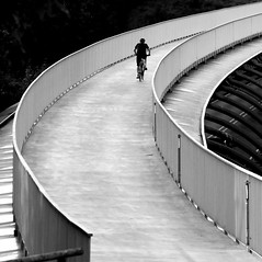 right hand bend (Wackelaugen) Tags: bycicle cycle person street bridge vaihingen stuttgart germany curves canon eos photo photography wackelaugen googlies black white bw blackwhite blackandwhite mono sterfeld