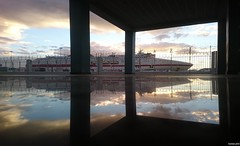Port terminal floor (KOSTAS PILOT) Tags: greece peloponese achaia patras port newportpatras reflection passengership cruiseolympia minoanlines terminalstation lowview sunset goldenlight goldenhour clouds sky shadow silhouette autumn symmetry symmetrical patracitysunset surface tile floor   mediterranean patraikos sony sonyz2 xperia                mirror
