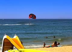 Beachlife (tombola007) Tags: parasail beach water slide sand sky