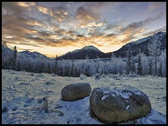 Rest Stop (Ed Boudreau) Tags: orange snow rock clouds sunrise boulder conifer chugachmountains alaskamountains rememberthatmomentlevel1 rememberthatmomentlevel2