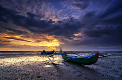 Jukungs Of Tuban (eggysayoga) Tags: longexposure blue sky bali cloud seascape beach sunrise indonesia landscape golden boat nikon mud magic tripod ss hard tokina filter le 09 lee hour nd perahu tuban pantai graduated waterscape gnd jukung 1116mm d7000